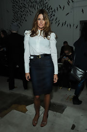 Kelly Bensimon showed off her model curves in a classic, fitted white blouse and denim knee-length skirt.