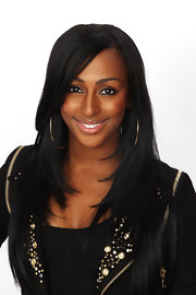 Alexandra Burke's long, layered cut with side-swept bangs looked pretty and polished in her backstage portraits.