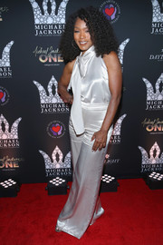 Angela Bassett donned a white satin jumpsuit for Michael Jackson's diamond birthday celebration.