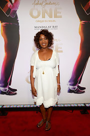 Alfrie Woodard kept her look light and summery with a white frock and matching white cardigan.