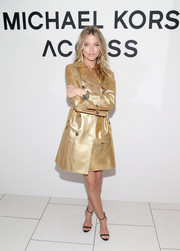 Martha Hunt arrived for the Michael Kors Access Smartwatch launch wearing a shimmering trenchcoat from the label.