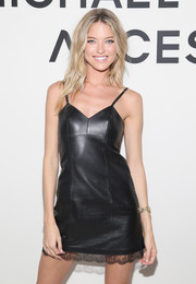 Martha Hunt smoldered in in a black leather slip dress with a lace hem at the Michael Kors Access Smartwatch launch.