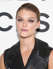 Nina Agdal rocked a slicked-down updo at the Michael Kors Access Smartwatch launch.