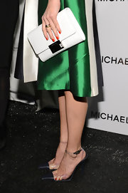 Hilary Swank kept her accessories simple with this white clutch with a large buckle.