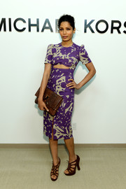 Freida Pinto made a fab choice with this purple and taupe Michael Kors print dress featuring a midriff cutout when she attended the brand's fashion show.