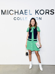 Aimee Song kept it sweet and youthful in a green polka-dot pussybow dress by Michael Kors during the brand's fashion show.