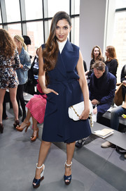 Deepika Padukone looked smart in a sleeveless blue coat by Michael Kors while attending the brand's fashion show.