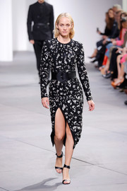 Amber Valletta walked the Michael Kors runway wearing a high-slit dress adorned all over with clusters of sequins.