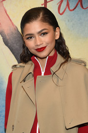 Zendaya Coleman sported a loose hairstyle that was slick at the top and curly down the ends when she attended the Michael Kors fashion show.