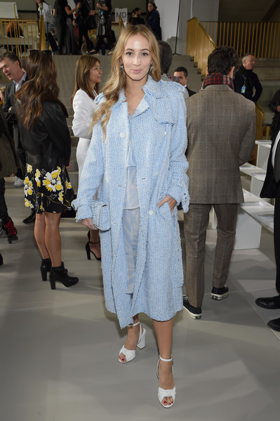 Harley Viera-Newton attended the Michael Kors fashion show wearing a pastel-blue tweed trenchcoat from the brand.