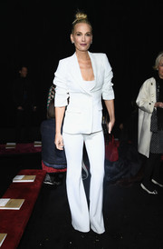 Molly Sims kept it simple in a white pantsuit at the Michael Kors Fall 2019 show.