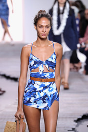 Joan Smalls was beach-chic in a cutout one-piece styled with a camel-colored leather belt at the Michael Kors runway show.