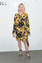 Naomi Watts cut a girly figure in a yellow and black floral dress by Michael Kors during the brand's fashion show.