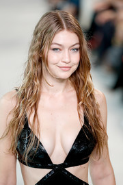 Gigi Hadid sported wet-look hair at the Michael Kors Spring 2019 show.