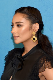 Shay Mitchell styled her hair into a ponytail with twisted sides for the Michael Kors Spring 2019 show.