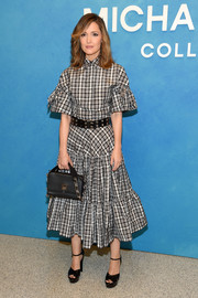 Rose Byrne looked cute in a plaid tie-sleeve shirt by Michael Kors during the brand's Spring 2019 show.