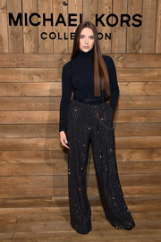 Ashley Benson kept it simple up top in a black Michael Kors turtleneck during the brand's Fall 2020 show.