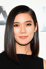 Tao Okamoto attended the Michael Kors fashion show wearing a flawlessly styled asymmetrical bob.