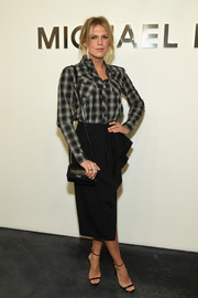 Alexandra Richards was masculine-chic up top in a monochrome plaid button-down by Michael Kors during the brand's fashion show.