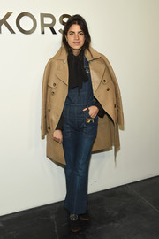 Leandra Medine topped off her overalls with a fierce camel-colored leather trench coat by Michael Kors.