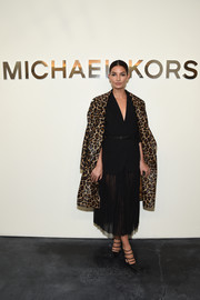 Lily Aldridge made a stylish appearance at the Michael Kors fashion show in a leopard-print leather coat from the brand.