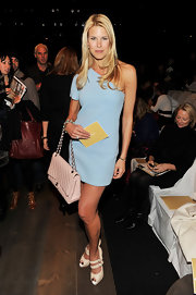 Beth attended the Michael Kors Fashion Show in a periwinkle blue one-shouldered gown. She paired her delicate cocktail dress with a timeless soft pink Chanel bag. For some reason the two colors remind us of a baby shower. No?