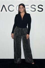 Ashley Graham jazzed up her top with a pair of chain-striped wide-leg pants by Michael Kors.