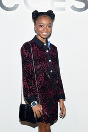 For the event, Skai Jackson paired a black chain-strap bag with a two-tone shirtdress, both by Michael Kors.