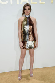 Hailee Steinfeld sealed off her high-shine look with silver ankle-strap sandals, also by Michael Kors.