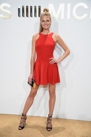 Constance Jablonski was fun and flirty in a red skater dress by Michael Kors during the brand's fragrance launch.
