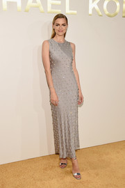 Jaime King complemented her lovely dress with silver ankle-strap sandals, also by Michael Kors.