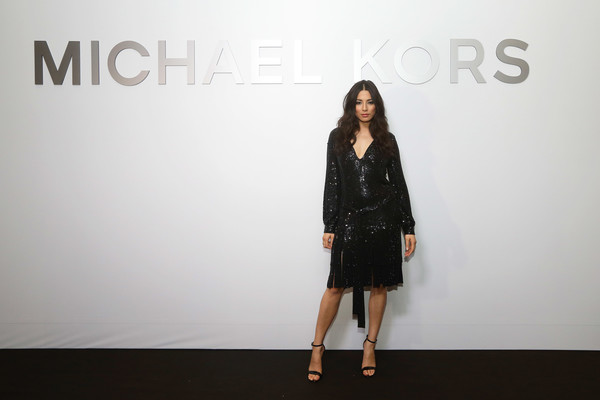 Jessica Gomes was flapper-glam in a black sequin dress with a fringed hem at the Michael Kors Mandarin Gallery flagship store opening.