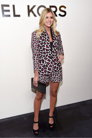 Kate Young made a bold statement with this animal-print short suit at the Michael Kors fashion show.