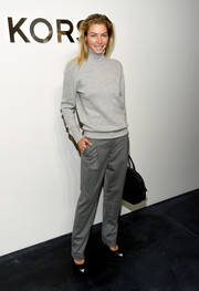Jessica Hart was monochromatic-chic in her gray Michael Kors slacks and turtleneck combo.