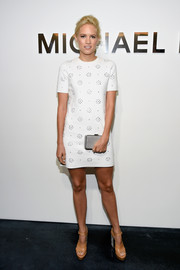 Cody Horn accessorized with a beaded Michael Kors Elsie clutch for a bit of glitter to her look.