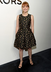 Jessica Chastain completed her look with a pair of black ankle-strap sandals, also by Michael Kors.
