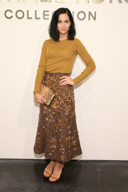 Sticking to her autumn color palette, Leigh Lezark accessorized with a snakeskin clutch.