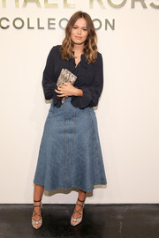 Atlanta de Cadenet donned a simple yet chic navy ruffle blouse for the Michael Kors fashion show.