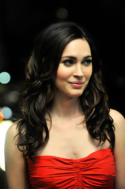 Megan Fox wore her glossy brunette tresses in loose curls.