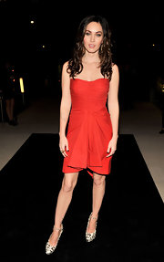 Megan Fox sizzled in a little red dress and leopard print ankle strap pumps.
