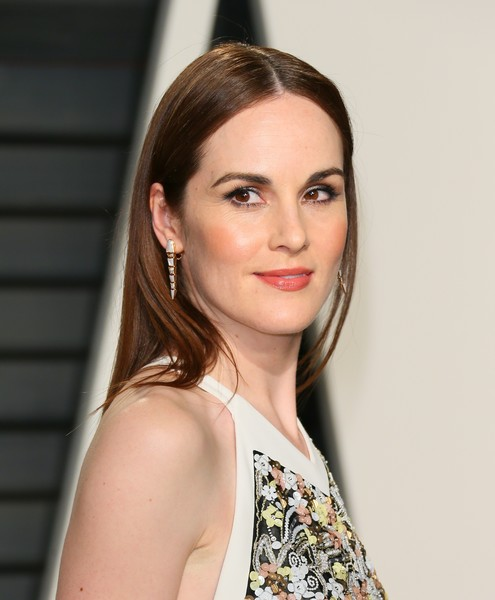 Michelle Dockery Dangling Gemstone Earrings [hair,face,hairstyle,lip,eyebrow,beauty,chin,skin,blond,fashion,michelle dockery,graydon carter - arrivals,jean-baptiste,british,wallis annenberg center for the performing arts,vanity fair,oscar party,vanity fair party,afp,academy awards]