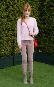Bella Thorne went for a monochromatic finish, pairing mauve Free People skinny jeans with her sweater.