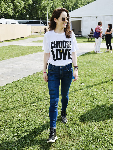 Michelle Dockery Graphic Tee [clothing,jeans,white,street fashion,denim,t-shirt,footwear,shoulder,fashion,grass,michelle dockery,handout image,studios,ray-ban studios,victoria park,london,england,ray-ban,all points east festival]