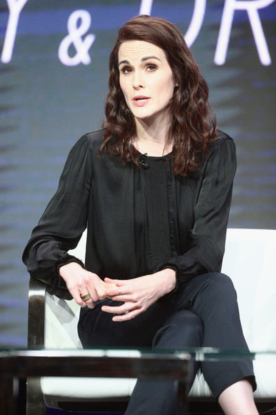 Michelle Dockery Loose Blouse [hairstyle,sitting,long hair,television presenter,white-collar worker,formal wear,photography,fashion model,brown hair,fashion design,michelle dockery,the beverly hilton hotel,beverly hills,california,tca,tnt tbss leading women of comedy and drama,turner networks,portion,summer television critics association press tour]