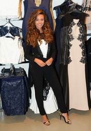 Michelle Keegan styled her suit with a pair of black and gold evening sandals.