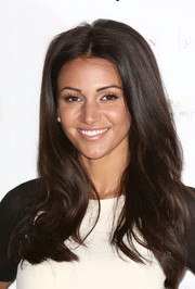 Michelle Keegan looked pretty with her face-framing waves during the launch of her Lipsy collection.