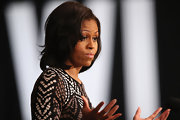 Michelle wore her hair in wavy layers for the Wisconsin campaign.