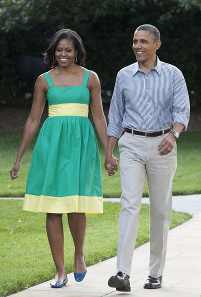 Michelle Obama Sundress [photograph,dress,standing,lady,beauty,shoulder,fashion,girl,formal wear,walking,barack obama,michelle obama,members,remarks,afp out,u.s.,south lawn,white house,congressional picnic,picnic]