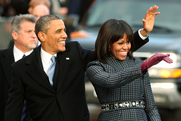 Michelle Obama Leather Gloves [inaugural parade held after swearing in ceremony,event,gesture,suit,photography,premiere,formal wear,finger,white-collar worker,bodyguard,smile,barack obama,michelle obama,president,parade winds,route,capital,u.s.,nation,term]