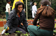 Michelle Obama was appropriately dressed in a black utility jacket while working at the White House Kitchen Garden.